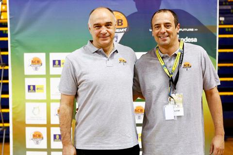 Coach Hugo con Pablo Laso